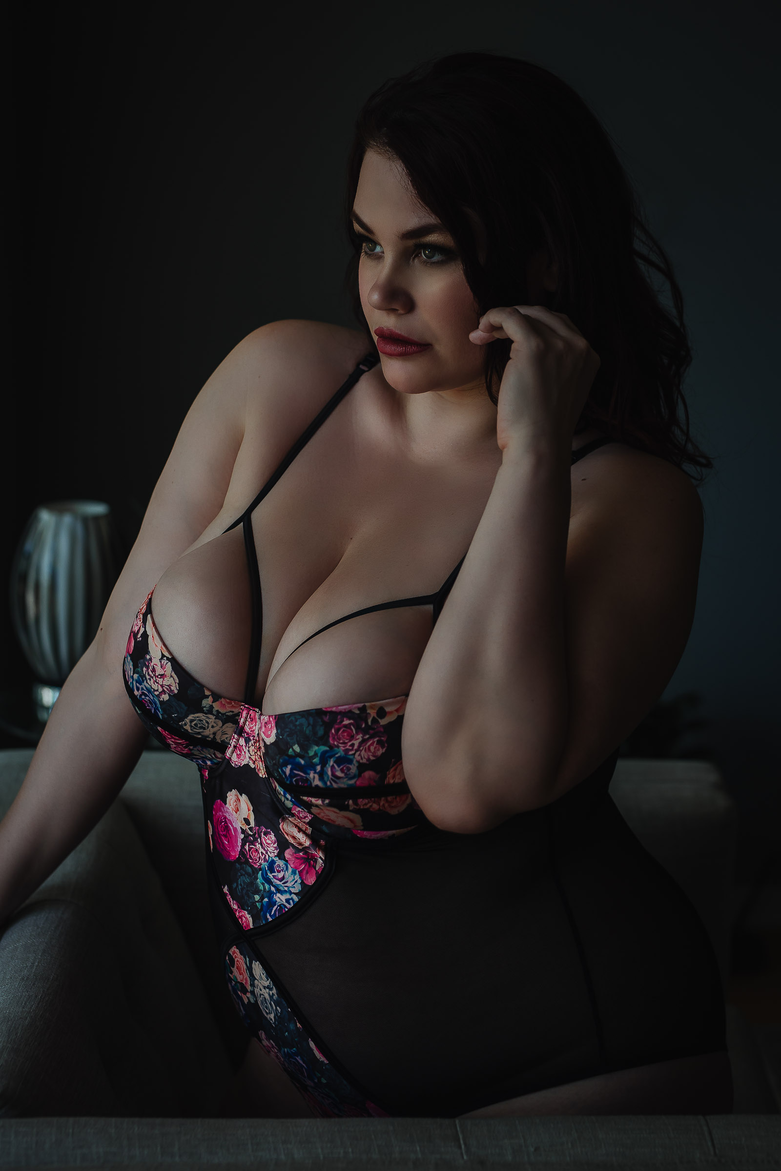 Picture of beautiful curvy brunette wearing bodysuit taken at Toronto boudoir photography studio