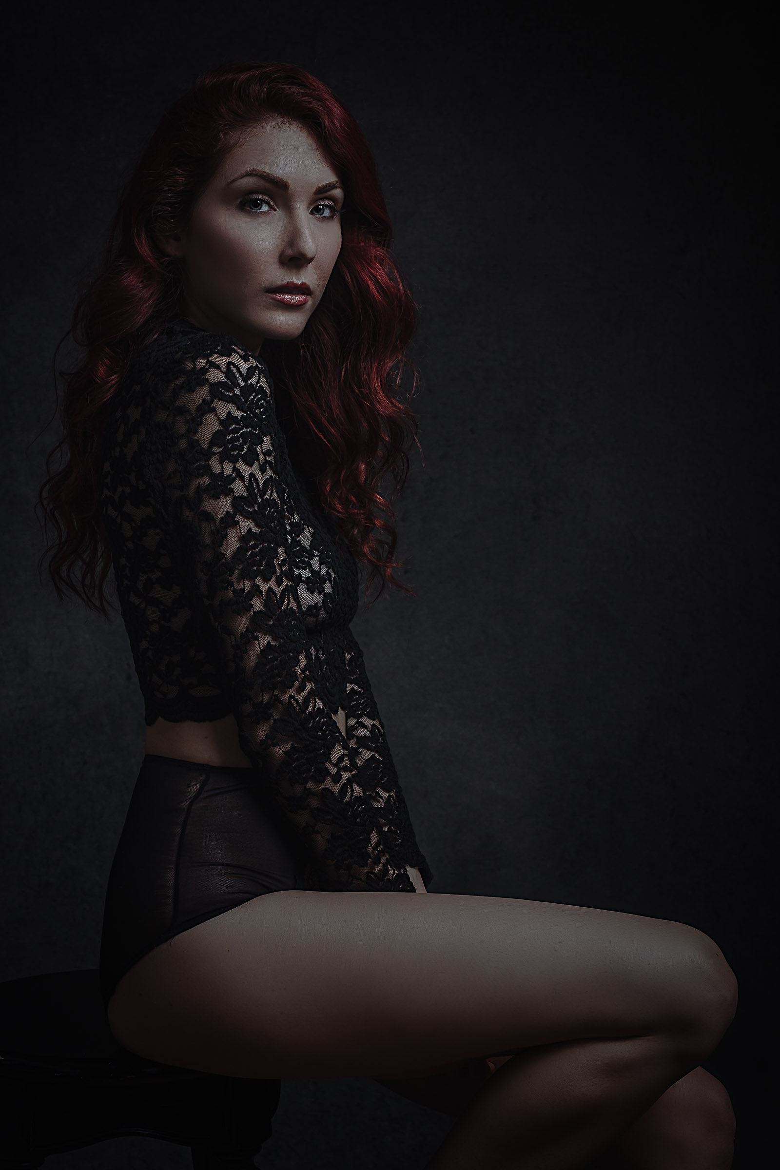 Beautiful redhead wearing lace top in Toronto Boudoir Portrait